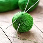 Knitting needles in the ball of threads – спицы в клубке
